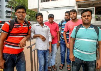 Jobless and unpaid, foreign workers face daunting fate