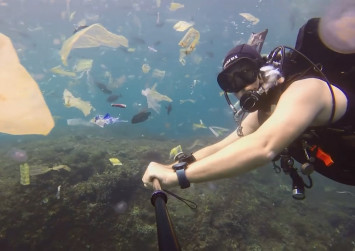 Diver films rubbish wasteland in Bali waters