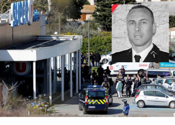 'Hero' French policeman who took place of hostage dies: Minister
