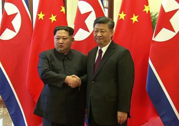 North Korea's Kim Jong Un met China's Xi Jinping on first foreign trip