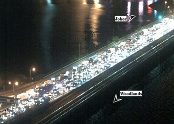 Traffic builds up on Johor Causeway after Malaysia PM announces movement control order