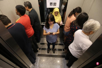 Facing the wall the new social distancing measure in Maybank Tower lifts