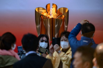Thousands flock to see Olympic flame in Japan despite coronavirus fears