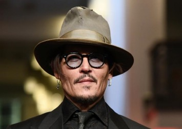 Johnny Depp branded ex-wife Amber Heard as 'scum' in text messages sent after their divorce was finalised