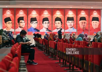 'Umno's beauty is its embrace of diversity': Malaysia's biggest party meets amid divisions over backing PM Muhyiddin