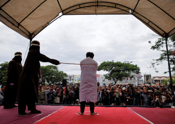Gay Indonesians caned in front of jeering crowd in Aceh for having sex