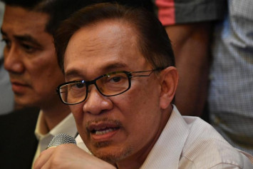 Policeman in Malaysian murder scandal should face new trial: Anwar