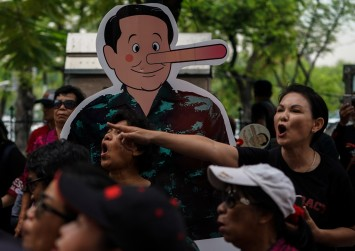 Thai protesters march in Bangkok, police set up barriers