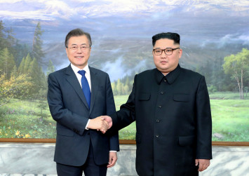 Leaders of two Koreas hold surprise meeting as Trump revives summit hopes