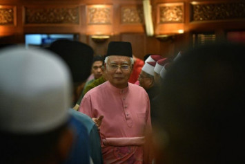 Former Malaysia PM Najib and family barred from leaving country