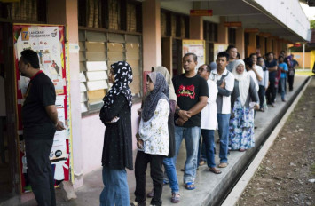 Malaysia election: Second person collapses and dies while waiting in line to vote