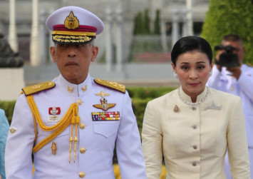 From bodyguard to Queen, Thailand's Suthida makes public debut