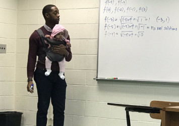 Georgia professor carries student's baby so he can take notes in class