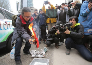 He burned a Chinese flag outside Meng Wanzhou's court hearing. Here's why