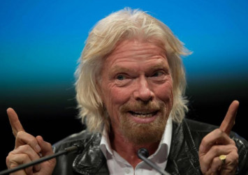 British billionaire Richard Branson says he will fly to space by July
