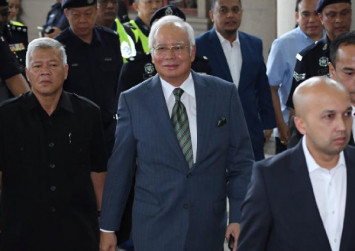 Najib's trial postponed again after lawyer injured by pet dog