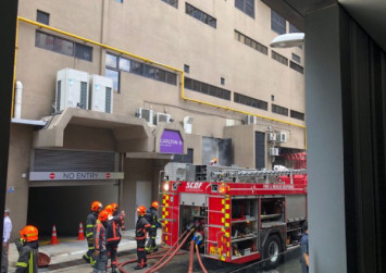 Loud explosions heard at Carlton Hotel, smoke seen coming from door at back of premises