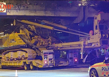Crane crashes into overhead bridge at Jurong Town Hall Road