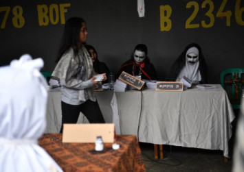 Indonesia votes: Ghosts and vampires draw voters to ballot box