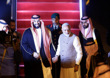 India's Narendra Modi breaks protocol to welcome Saudi's crown prince