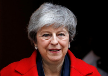 UK PM opens way to three-month Brexit delay