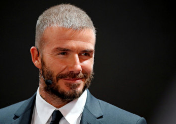 Ex-England star David Beckham admits using phone while driving, police say