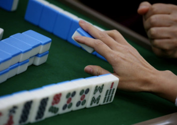 Chinese teachers detained and demoted for playing mahjong at home