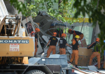 Over 90 employees of quake-hit Philippines supermart remain unaccounted for: Vice governor