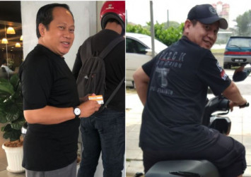 Malaysia's opposition wears black on 1st anniversary of Pakatan Harapan government