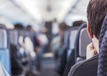 Traveller who charges obese man $150 for taking up part of his plane seat fuels online debate