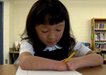 10-year-old Chinese girl with no hands wins US handwriting competition