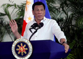Philippines' Duterte tells China to 'lay off' island in disputed waters