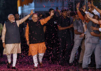 Modi vows 'inclusive' India after landslide election win