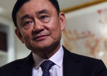 Thailand suspends TV channel linked to ex-PM Thaksin ahead of polls