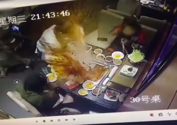 Haidilao China investigates hotpot exploding in waitress' face after she fishes for lighter dropped by customer