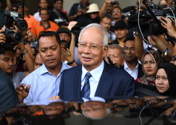 Malaysia's ex-PM Najib gears up for graft trial with charm offensive