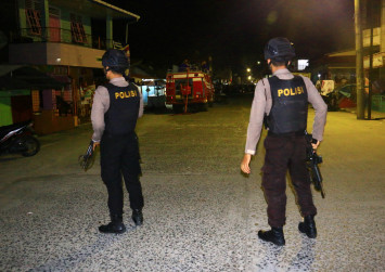 Bomb wounds Indonesian police officer after militant arrested