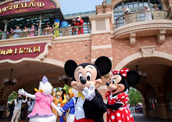 All masks, no fireworks: Shanghai Disneyland in muted reopening after coronavirus closedown