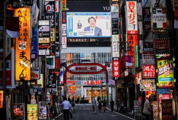 Japan's regions emerge from virus emergency while Tokyo enters 'new normal'