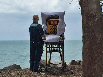 Australian ambulance crew grants dying woman's last wish to visit the beach