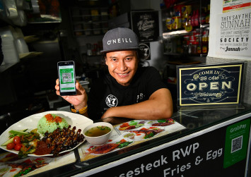 Grab launches e-wallet for eateries, retail shops in Singapore