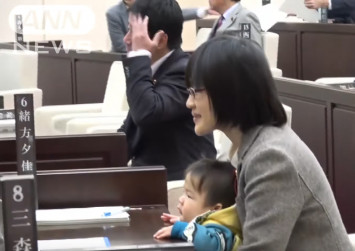 Japan politician with baby ejected from chamber; sparks debate