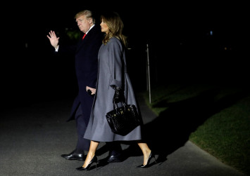 Trump under pressure from Melania to fire top aide