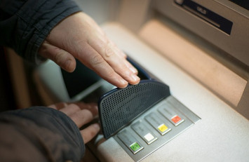 ATM mistakenly dispenses US$100 bills; bank lets customers keep the money