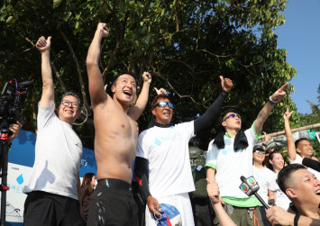 Olympian and Canto-pop star Alex Fong swims around Hong Kong Island