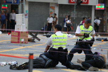 Hong Kong officer who shot protester gets death threats against children, police say
