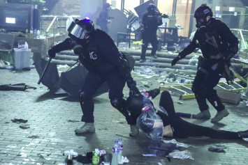 Thousands hit Hong Kong streets in bid to end police campus siege