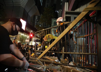 Hong Kong protester who spat at police officer gets 10 months in jail