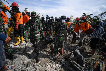 Schools in Indonesia quake city begin counting how many children will be back