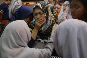 Lion Air crash: Tearful relatives of victims demand answers